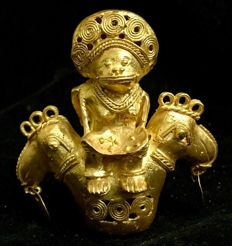 A fabulous , and , very rare , double sided , antropomorphic and zoomorphic ,Tumbaga Gold , artifact , Colombian , Tairona Culture ,   98 x 92 x 57 mm ,  120,61 grams ,   A ritual amulet , offering priest and priestess riding a couple of paradise birds
