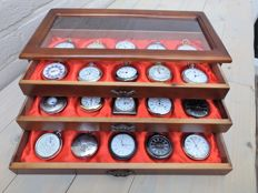 30 Quartz pocket watches all mint in a beautiful display case