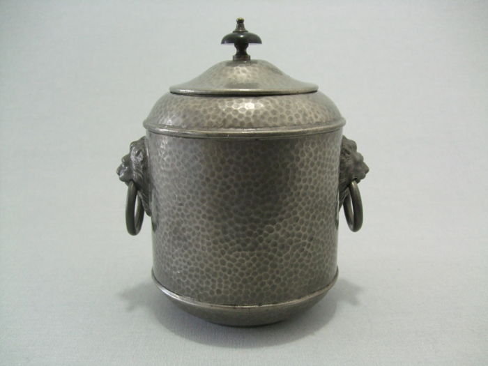 Tobacco pot, made from hammered tin.