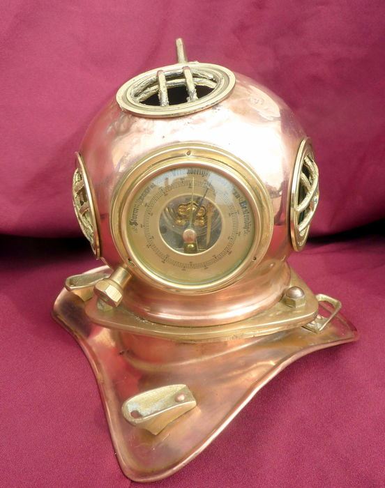 Model of a divers helmet with barometer