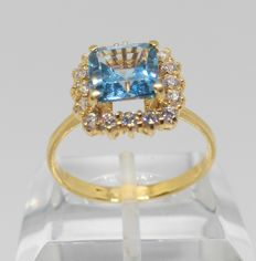 Yellow gold ring with blue stone and zirconias – Inner size: 18 mm