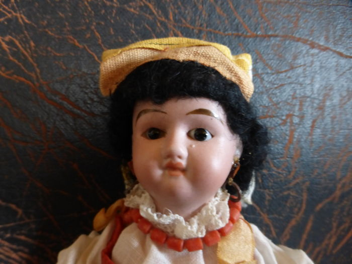 Small porcelain head doll around 1900 marked 47.12/ 0