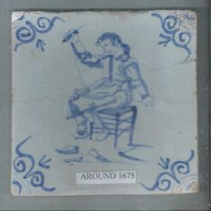 Tile with a depiction of a tailor