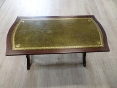 Mahogany Regency style coffee table with green leather table top and brass claw feet, England, second half of 20th century