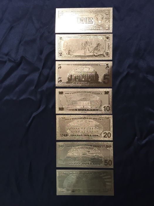 Set of 7 hand engraved USA banknotes in 24 kt gold leaf.