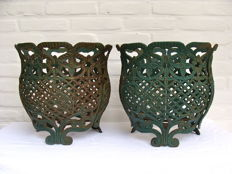 A pair of cast iron planters/flower pots in Victorian style