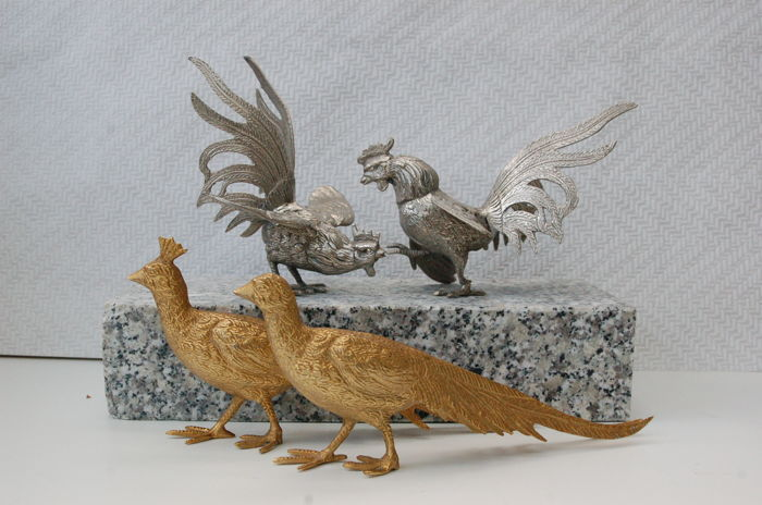 Pair of giltwood peacocks and a set of silver plated gamecocks.