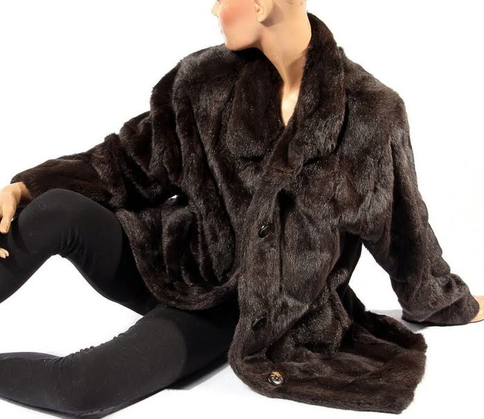 Elegant fur coat made of hamster fur, like mink, soft, velvety