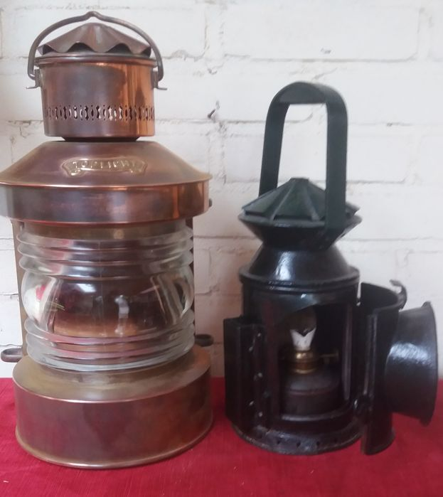 Ship's lamp made of copper and train lamp made of iron.
