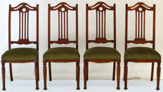 Four solid walnut dining chairs with green velour upholstery - ca. 1890