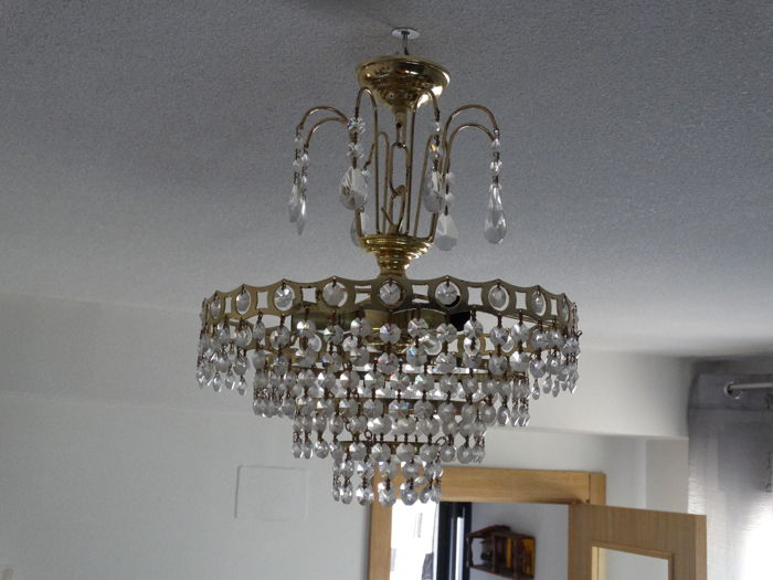 Chandelier lamp, 4 rings of brass, cut-glass