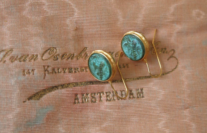 Old earrings with Roman coins