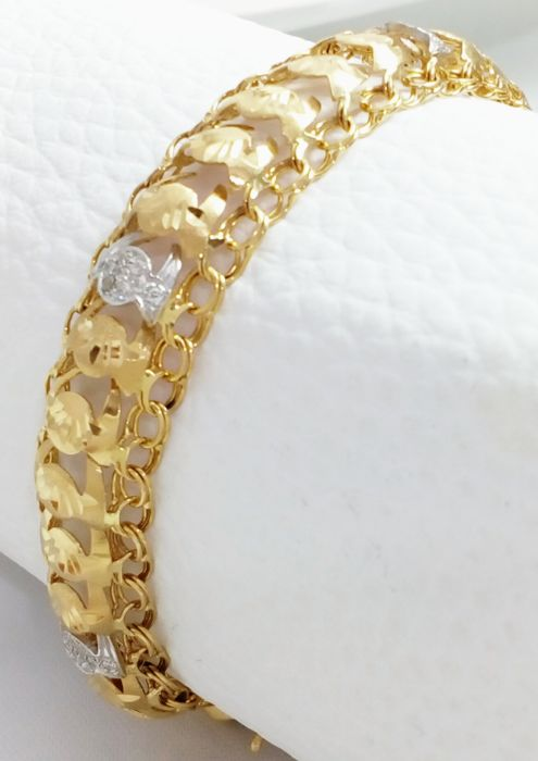 Princess bracelet in 18 kt/750 yellow and white gold. Weight: 18.6 g.