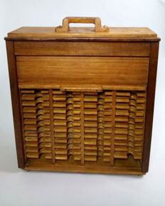 Tambour/shutter fronted wooden collectors cabinet, England, 1950s