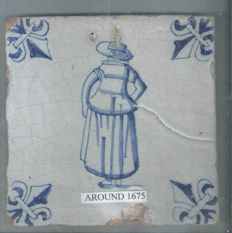 Tile with a person decor