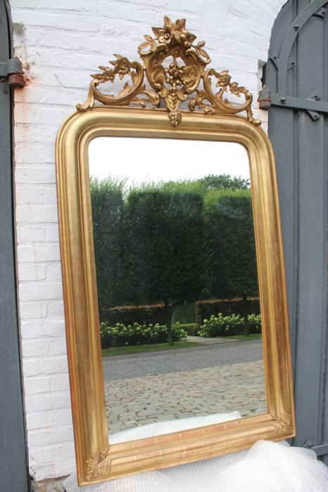 Mirror in Louis XIV style with crest in gold leaf - France - ca. 1820