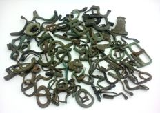 Bronze buckles 15x12- 49x30 mm and ancient roman fibulae and backrests fibulae 27-58 mm (102 pcs)
