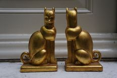 A pair of elegant and stately felines as bookends, finished with gold leaf