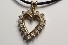 14 kt gold pendant with brilliant cut diamond 0.60 ct.