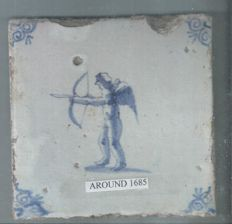 Tile with a cupid