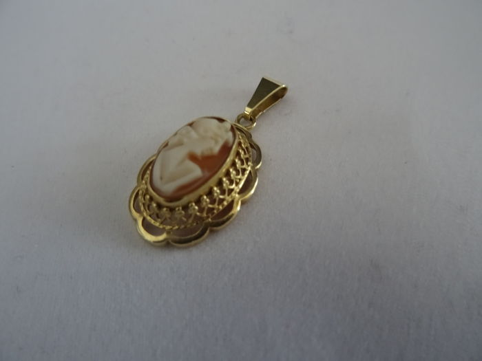 14 karat gold pendant with a hand-carved cameo.