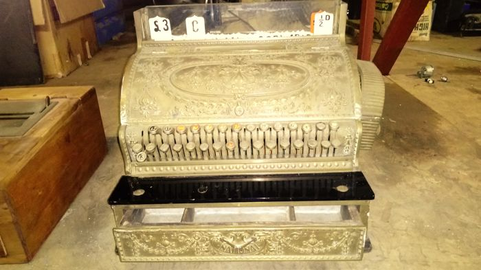 International checkout counter with cash register