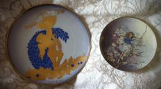 Two decorative wall plates: L' Amore (Morbelli Arte) and Das Schledorn-Märchen (Villeroy&Boch)