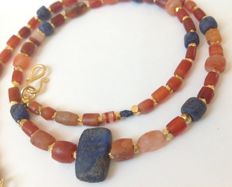 Strand of ancient carnelian and lapis lazuli beads, ca. 45 cm