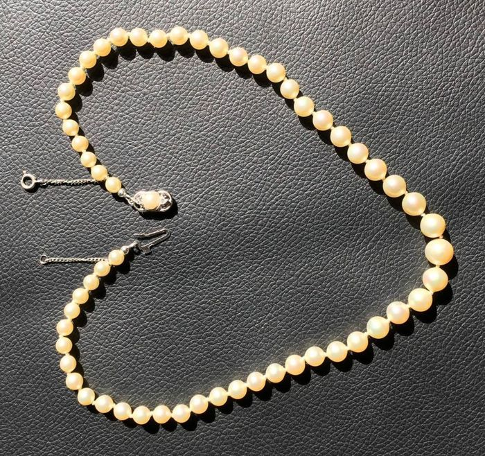 Akoya pearl necklace with Art Deco clasp and safety chain.