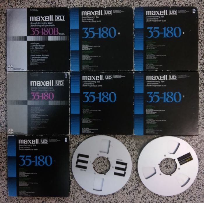 Nine aluminum 26cm reeltapes by MAXELL, AMPEX