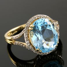 14 kt Yellow Gold 0.25 ct Diamonds and 6.50 ct Blue Topaz Ring  ,  Size: 6.5  - ***No Reserve***