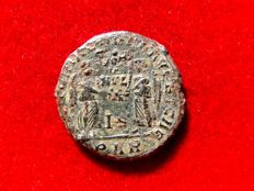 Roman Empire - Magnentius (350 - 353 A.D.) bronze maiorina (3,50 g. 20 mm.) from Arles mint. Victories holding shield inscribed VOT V MVL X. IS/ PARL