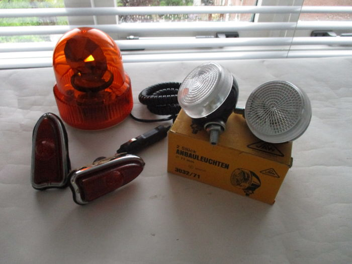 Lot of automobile lighting - Blinkers, spotlights and an orange flashing light 12 V - for on a car