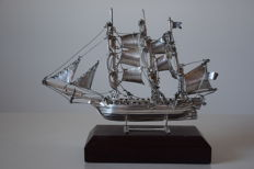 Model sailing ship in silver.