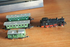 Märklin Z - lot consists of 1 locomotive Series BR74, 2 passenger carriages and 1 baggage carriage of the DB