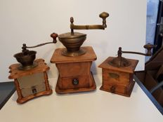 Three antique working hand coffee mills