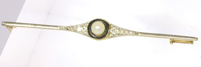 Art Deco bicolour gold brooch with diamonds, a pearl and black enamel, anno 1920