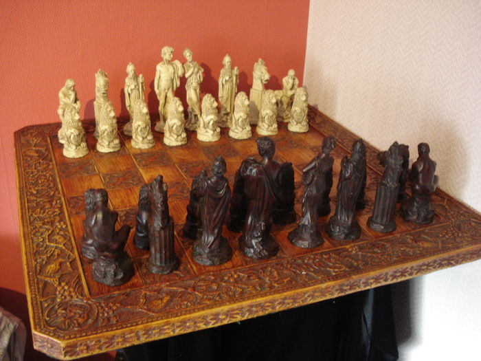 Old vintage large processed chess set with pawns from Greek mythology