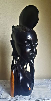 Female bust made of wood from Senegal