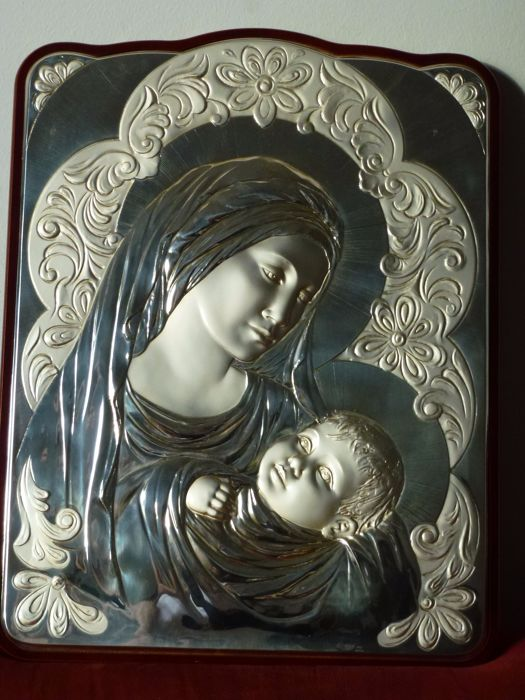 Catholic Christian devotional item - 925/1000 silver (40 to 46 g) on wood - important and large-sized icon of the Virgin and Child surrounded by bas-relief floral decorations, of outstanding brightness - hand-made cantilever processing by silversmith no.