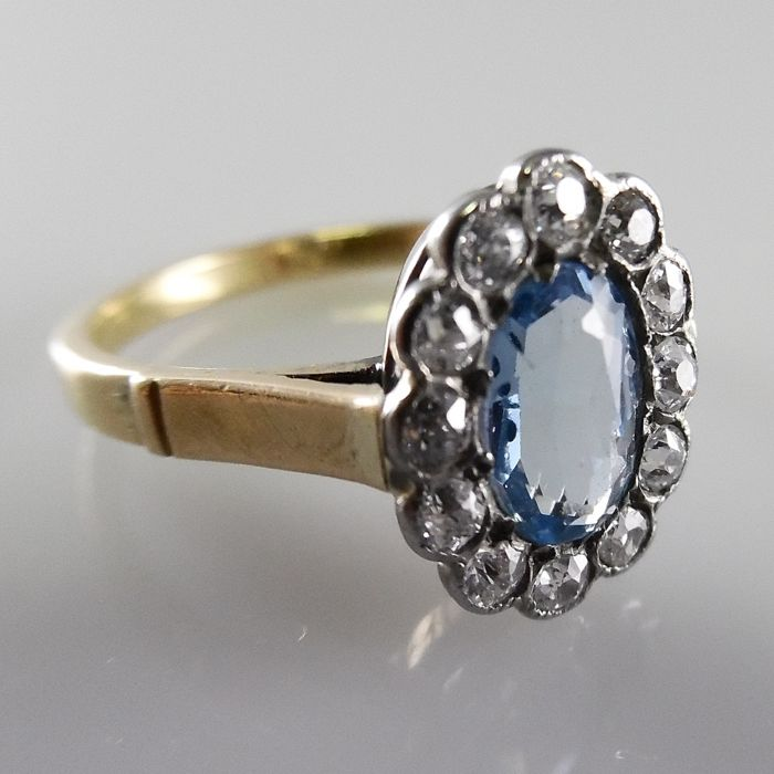 Ring with blue topaz and Bolshevik cut diamonds