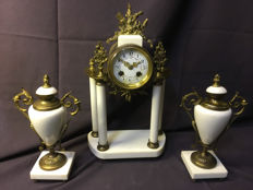 A Louis XVI style white marble mantle clock - France - late 19th century