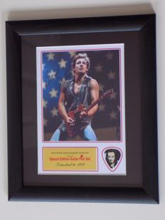 Bruce Springsteen preprinted signature and guitar pick display. Mounted and framed.
