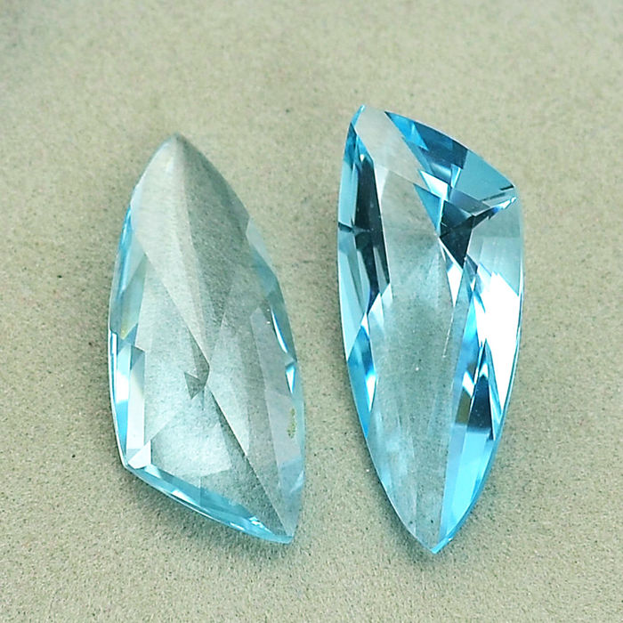 2 (pair) sky blue fantasy cut topazes– 20,38 ct total