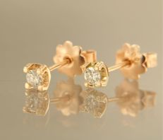 14 kt rose gold ear studs set with brilliant cut diamond, approx. 0.16 carat in total