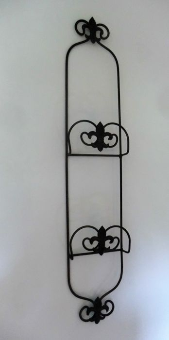 Wrought iron magazine / towel holder with French Lily