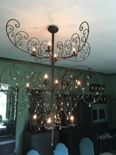 Iron wrought chandelier with pendants