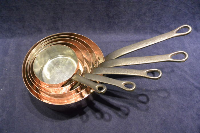 5 - piece hammered copper sauce pans set with tin.
