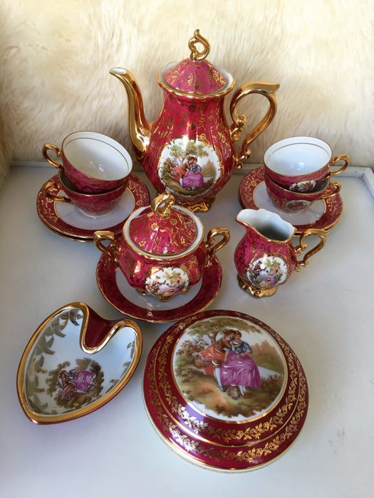 Limoges gilded porcelain tea set plus container and lidded box