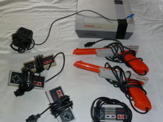 Nintendo NES including 4 controllers , 2 zappers and 10 games